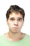 Retrato del hombre joven lamentable aislado en blanco Imagen de archivo