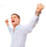Retrato del hombre joven que celebra éxito Foto de archivo
