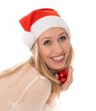 Retrato del invierno de la mujer alegre en el sombrero de Santa Imágenes de archivo libres de regalías