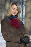 Retrato del invierno de una mujer joven Imagen de archivo libre de regalías
