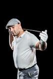 Retrato del jugador de golf que detiene a un club de golf Imagenes de archivo