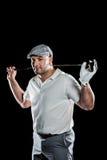 Retrato del jugador de golf que detiene a un club de golf Foto de archivo