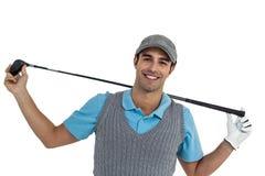 Retrato del jugador de golf que detiene a un club de golf Fotografía de archivo