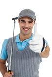 Retrato del jugador de golf que muestra los pulgares para arriba Imágenes de archivo libres de regalías