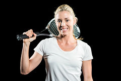 Retrato del jugador de tenis de sexo femenino que presenta con la estafa Imagenes de archivo