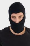 Retrato del ladrón que lleva un pasamontañas Fotografía de archivo libre de regalías