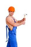 Retrato del mecánico atractivo con un martillo Fotos de archivo