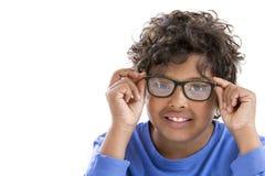 Retrato del muchacho agradable en vidrios con la camisa azul en blanco Fotografía de archivo libre de regalías