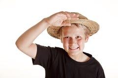 Retrato del muchacho con el sombrero de paja Fotografía de archivo libre de regalías