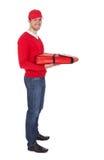 Retrato del muchacho de salida de la pizza con el bolso termal Foto de archivo libre de regalías