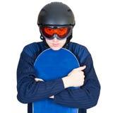 Retrato del muchacho en ropa de deportes con el snowboard Foto de archivo libre de regalías