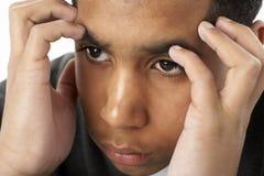 Retrato del muchacho joven tensionado Fotografía de archivo