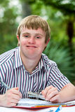Retrato del muchacho perjudicado con el fichero Fotos de archivo libres de regalías