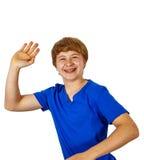 Retrato del muchacho que agita con la camisa azul Foto de archivo libre de regalías