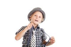 Retrato del muchacho rubio que lleva un sombrero Fotos de archivo libres de regalías