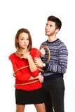 Retrato del muchacho y de la muchacha atada con la cuerda aislada en blanco Fotografía de archivo libre de regalías