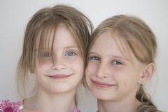 Retrato del niño de dos muchachas Foto de archivo