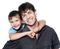 Retrato del padre y del hijo felices Imágenes de archivo libres de regalías