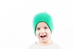 Retrato del pequeño niño enrrollado Imagenes de archivo