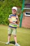 Retrato del pequeño jugador de tenis Imagen de archivo