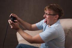 Retrato del perfil de un gamer emocionado Fotografía de archivo libre de regalías