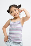 Retrato del primer de una pequeña muchacha asiática linda Fotografía de archivo