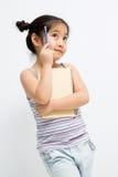 Retrato del primer de una pequeña muchacha asiática linda Imágenes de archivo libres de regalías