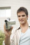 Retrato del profesional con la cámara de vídeo Foto de archivo libre de regalías