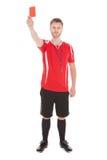 Retrato del árbitro que muestra la tarjeta roja Foto de archivo