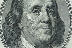 Retrato del ` s de Benjamin Franklin en cientos billetes de dólar Imagen de archivo libre de regalías