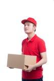 Retrato del servicio del hombre de entrega que entrega feliz el paquete a c fotos de archivo libres de regalías