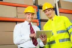 Retrato del trabajador y del encargado felices de Warehouse fotos de archivo libres de regalías