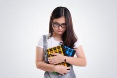 Retrato deprimido de la colegiala en blanco Foto de archivo libre de regalías