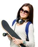 Retrato do adolescente com skate Fotografia de Stock Royalty Free