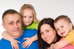 Retrato do agregado familiar com quatro membros feliz Fotos de Stock Royalty Free