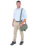 Retrato do carteiro com a mala a tiracolo no fundo branco foto de stock royalty free