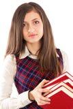 Retrato do close up do estudante que guarda uma pilha dos livros fotografia de stock