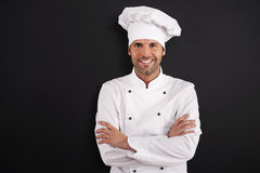 Retrato do cozinheiro chefe de sorriso imagens de stock