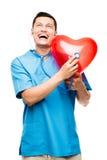 Retrato do doutor asiático feliz que escuta a pulsação do coração  imagem de stock royalty free