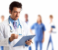 Retrato do doutor com sua equipe Imagem de Stock