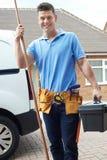 Retrato do encanador With Van Outside House Imagens de Stock