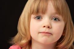 Retrato do estúdio da rapariga triste Foto de Stock Royalty Free