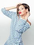 Retrato do estúdio de uma menina expressivo na camisa Imagens de Stock Royalty Free
