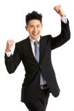 Retrato do estúdio do homem de negócios chinês que comemora imagens de stock royalty free