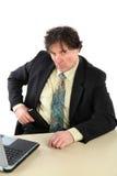 Retrato do fundo do branco de With Gun Over do homem de negócios Imagem de Stock Royalty Free