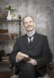 Retrato do homem com um livro Fotografia de Stock Royalty Free