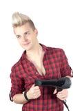 Retrato do homem considerável no vermelho com hairdryer Foto de Stock Royalty Free