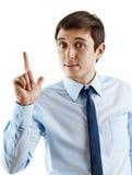 Retrato do homem de negócio novo que aponta acima Fotografia de Stock