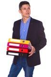 Retrato do homem de negócios feliz com dobradores Foto de Stock