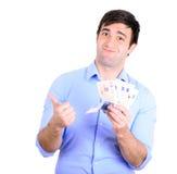 Retrato do homem de negócios feliz novo que guarda o dinheiro em suas mãos Imagem de Stock
